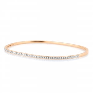 18 carat rose gold bangle with diamondsby Ginette NY